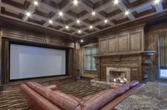 Home theater with large fireplace - personally, I think it would be distracting, but to each his own...
