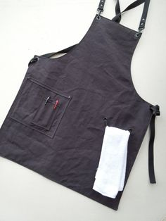"""ActionWar, etsy, army soft canvas apron, Single side pocket, towel hanger twill threaded through grommets, clip straps thread through grommets at back for crossover,  with  quick release. Removable straps would make laundering easier, so ties don't tangle. Small 28"""" x 25"""" wide"""