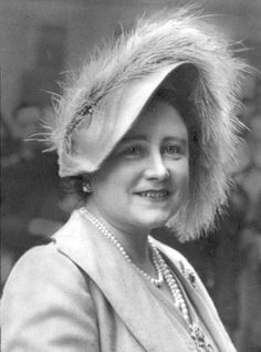 QUEEN ELIZABETH (Queen Mother ) (Died 30/3/02) October 1950.  Queen Elizabeth with a large Ostrich feather in her hat when she paid her annual call on the Lord Roberts Memorial Workshops at Dundee , Scotland in 1950. -