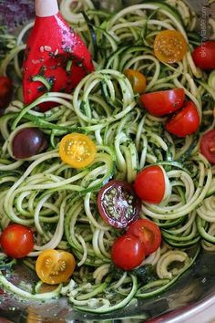 Raw Spiralized Zucchini Noodles with Tomatoes and Pesto is my favorite easy, end-of-summer vegetarian dish made with raw, garden vegetables and homemade pesto. Pesto Dishes, Vegetable Dishes, Vegetable Recipes, Vegetarian Recipes, Vegetarian Dish, Vegetable Slicer, Vegetable Spiralizer, Zoodle Recipes, Spiralizer Recipes
