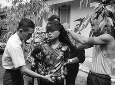 """Police in Da Nang cover the eyes of a woman who was an alleged member of a Viet Cong terrorist unit on Oct. 26, 1972.The woman was captured carrying 15 hand grenades, during the previous night's battle in Da Nang."" Some women are just dangerous"