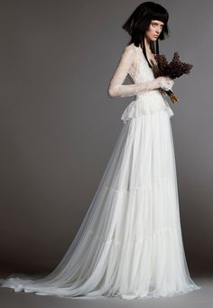 MADELEINE is a light ivory V-neck silk mermaid wedding gown with illusion high neck accented by hand placed Chantilly lace applique by Vera Wang.