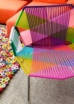 Colorful string chair...I'm totally going to find an old frame and do this with paracord. Check out our great selection of paracord as super low prices... http://www.osograndeknives.com/store/catalog/parachute-cord-311-1.html