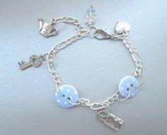 Charm bracelet with polka dot buttons button by JewelryArtShop https://www.etsy.com/listing/239470855/charm-bracelet-with-polka-dot-buttons?ref=shop_home_active_25