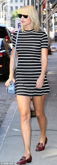 Stunner: She teamed the short dress with a pair of burgundy leather loafers while strutting her stuff down the street in the Big Apple