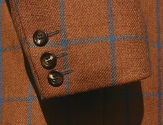 Tweed in shades of brown and blue.