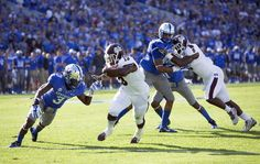 Mississippi State running back Josh Robinson (13) gets past Kentucky cornerback Fred Tiller, left, to make it to the end zone for his team's first touchdown in the first half of an NCAA college football game at Commonwealth Stadium in Lexington, Ky., Saturday, Oct. 25, 2014