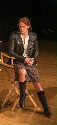 Sam Heughan check out the boots.  And look, his socks match his outfit!