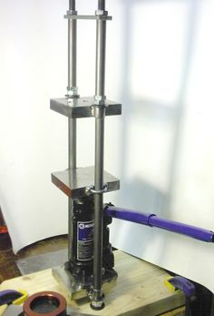 Prototype for mini hydraulic press built from three 4-inch steel bench blocks and a $10 bottle jack!