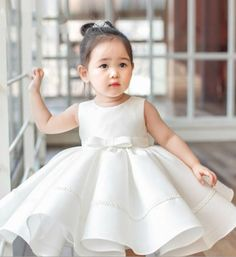White Flower Girl Dress---Made To Order - High Quality Chic & Elegant Sleeveless Knee Length Round Neckline Big Bow Back Baby Girl Party Dress. Perfect dress for wedding, birthday, baptism, communion or any special occasion. Available from 3 month until 12 years old. Color: White. Material: Satin, soft polyester fiber, cotton, tulle mesh. Before checkout, you may leave a note your little girl's height, bust and waist measurements so we can process it and send you the right size. Thank you…