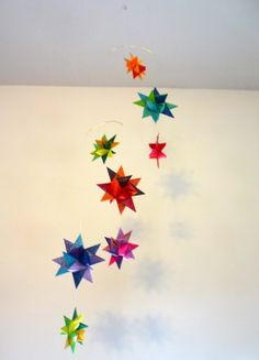 Modern Baby Crib Mobile Origami Paper Stars - I think hanging origami stars  at different heights over the art desk and reading nook would be super cute.