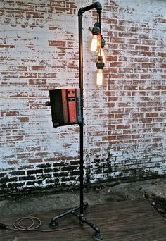 Antique Industrial Iron Pipe Floor Lamp Bookshelf With Pendant Lighting Industrial Floor Lamps, Industrial Lighting, Rustic Industrial, Industrial Furniture, Industrial Bookshelf, Furniture Vintage, Vintage Lamps, Industrial Design, Pipe Lighting
