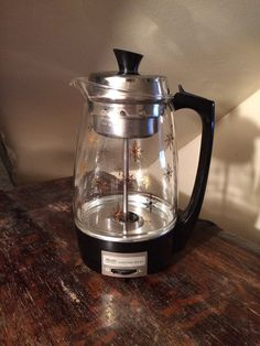 I love my beautiful percolator, I can't wait till we move to the new apartment and this beauty gets to sit in a spot of pride and glory!   Vintage 1970s Proctor Silex Percolator 11 Cup Coffee Pot - Mid-Century Glass Steel & Plastic With Gold Atomic Star Design