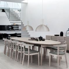 The Skovby SM78 is an ingenious extending dining table that makes seating additional guests a breeze. The elliptical tabletop separates to allow the two supplied extension leaves to be added, and a further two leaves are available separately to extend the table even further. I It is not just the top..