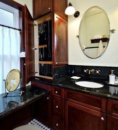 Interesting jewelry cabinet, Vintage-inspired master bathroom  Interior Designer: Carla Aston / Photographer: Miro Dvorscak / jewelry cabinet, black marble, cafe curtain