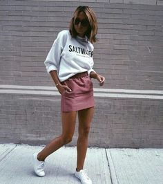 graphic pullover and rose colored mini skirt