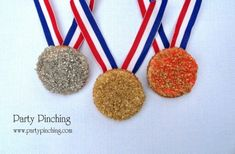 Gold, silver and bronze Olympic medals made from Ritz crackers dipped inchocolate olymp parti, medal cooki