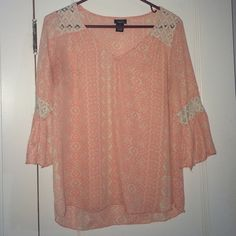 Three quarter length sleeve Rue 21 shirt Coral. Comfortable. Smaller in the arms. Medium. Rue 21. Rue 21 Tops Blouses