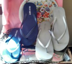 Old Navy flip flops - 2 pair: Silver-gray with 2 inch heel, and dark blue, sticker marked US size 7.