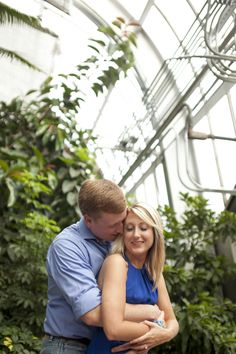 Romantic, colorful greenhouse engagement session with sweet details. Lovely garden engagement portraits. Diamond's Direct engagement ring.