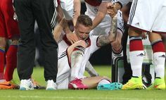 Germany's midfielder Marco Reus reacts injured on the pitch during the friendly football match Germany vs Armenia in preparation for the FIFA World Cup 2014 on June 6, 2014 in Mainz, central Germany.