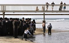 Oct 7, 2008 Ultra-Orthodox Jewish men prayed on the banks of the Yarkon River in Tel Aviv during Tashlikh Tuesday. The ritual, which precedes Yom Kippur, involves casting away last year's sins in a body of water. (Jonathan Nackstrand/Agence France-Presse — Getty Images)