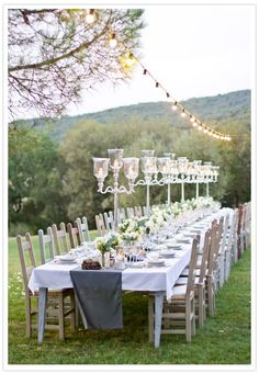 Outdoor party time / love the string of lights over the eating area. Could be great for a wedding!