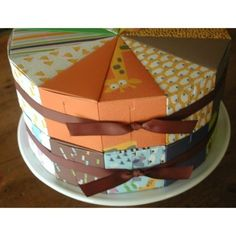 Cake slice favor boxes from KatherinePageDesigns (esty) Sale: $27 for 2 cakes/24 slices