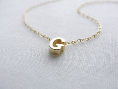 Tiny gold or silver letter necklace - Gold initial necklace. $26.00, via Etsy.