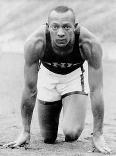 Jesse Owens wins 4 gold medals in the 1936 Olympics. THIS BEST part of this is he won them in Germany when Hitler was in charge. :-)