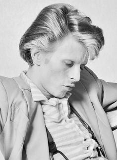 David Bowie    Fame, makes a man take things over  Fame, lets him loose, hard to swallow  Fame,puts you there where things are hollow  Fame     Fame, it's not your brain, it's just the flame  That burns your change to keep you insane (sane)  Fame