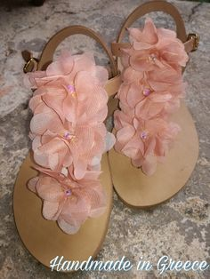 Handmade leather sandals,decorated with pink satin flowers and Swarovski crystals...