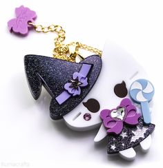 This+adorable+little+witch+will+only+cast+sweet+spells~!+    She+is+crafted+from+multiple+layers+of+black+sparkle+and+pastel+acrylic.++Her+hat+and+bow+are+accented+with+star+and+heart+shaped+Swarovski+crystals.+Her+lollipop+and+dress+feature+painted+details.+    She+is+available+in+your+choice+of...