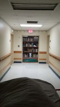Exit Door disguised as bookcase in Alzheimers Ward http://ift.tt/2g6yuSx