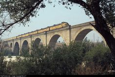 """Union Pacific Railroad EMD E8(A) - Santa Ana river bridge, Riverside, California, 1971. Union Pacific's the """"City of Los Angeles"""" is seen east bound during the last months of operation before Amtrak takes over."""