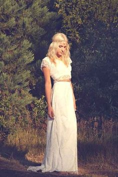 With a surprising crop top.   36 Of The Most Effortlessly Beautiful Boho Wedding Dresses Ever