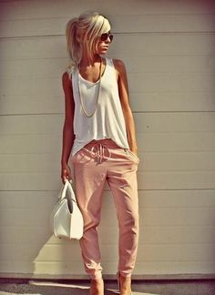 Pink lose pants. Loose white tank. Long gold chain necklace. Chill outfit. I could go without the bag.
