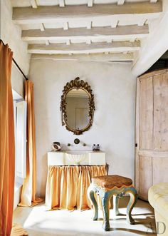 A mix of intricate antiques and shabby upholstery.