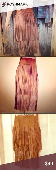 🌟TOP RATED BOHO CHIC VEGAN SUEDE FRINGE SKIRT 🎡 🎡FESTIVAL READY🎡 🌟TOP RATED🌟Cognac Color Vegan Suede Fringe Midi Skirt. Has Zipper in the Back. Love This! Size is Med. but runs Small. Size Down. Listing as a Small. ONLY ONE LEFT! 🎡 Skirts Midi