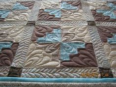 Intricate quilting design increases the impact and beauty of a simple quilt pattern. Lovely