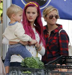 Vibrant tresses: On Sunday Reese Witherspoon's 15-year-old daughter Ava Phillippe (center) was spotted rocking fuchsia locks while out at a Los Angeles farmer's market