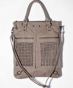 7 Chi Studded Tote worn by Riley Perrin on Baby Daddy. Shop it: http://www.pradux.com/7-chi-studded-tote-28031?q=s58