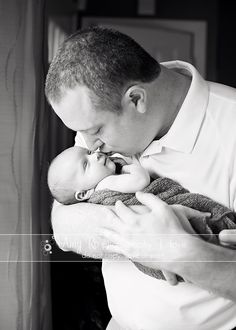 Newborn picture of dad kissing baby, Amy Ro photography newborn portraits RI