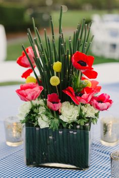 Be Mine Event   Wedding in Tampa Bay   Wizard of Oz themed centerpieces made with Red Anemone, Yellow Billy Balls, and Horsetail. #andrealaynefloraldesign #tampaweddings #wizardofoz