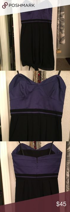BCBGeneration strapless dress size 0 Very cute strapless dress, purple and black with a cute knot on the bottom of dress! BCBGeneration Dresses Mini