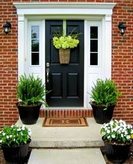 Hazel Loves Design BLOG - Exquisite Black Front Door, traditional feature, on red brick home, with white detailing paint.  Big black pots!  WoW!