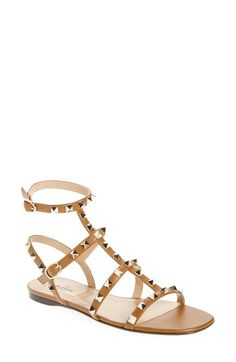 Free shipping and returns on Valentino Rockstud Gladiator Sandal (Women) at Nordstrom.com. Regimented rows of pyramid studs punctuate the intersecting leather straps of an edgy gladiator sandal that will add a high-fashion touch to your everyday look.