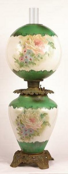 Gone with the Wind table lamp. Base and ball shade, large handpainted roses, green and white background with scroll painted bands, excellent cast reticulated feet, head and lion pattern, font rim with florals, electrified, America, circa 1850-1899