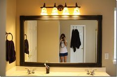 Build a frame around a frameless mirror with stock molding.
