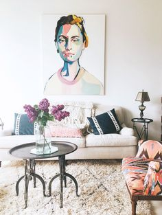oversized portrait painting in bohemian modern living room. / sfgirlbybay